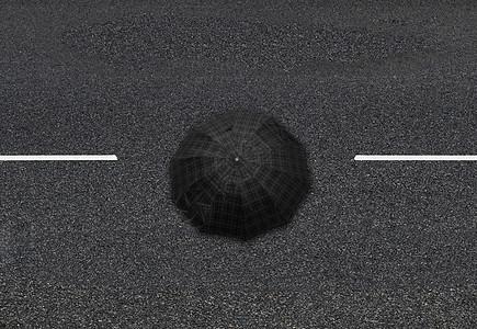 雨天马路上黄线中打伞行走的路人图片