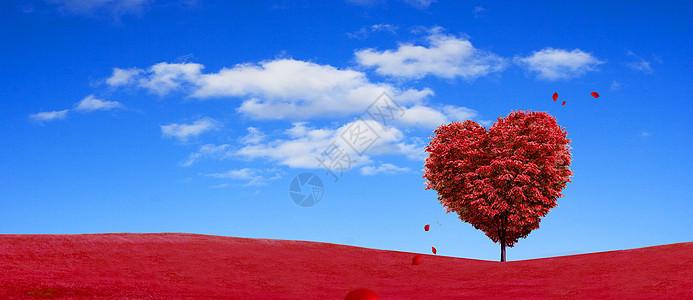 蓝天白云下的红色爱心树图片