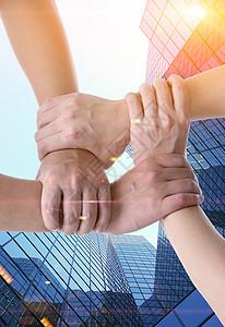 商务团队握手合作背景图片
