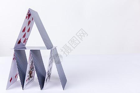 团队创意扑克搭建留白拍摄图片