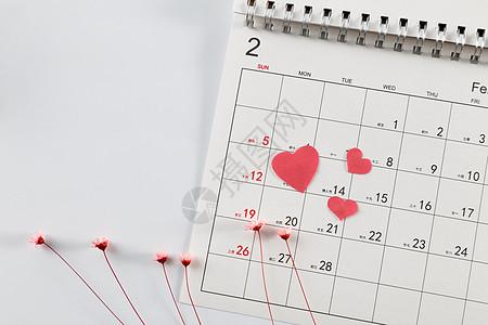 情人节日历爱心粉色碎花在白色背景上图片