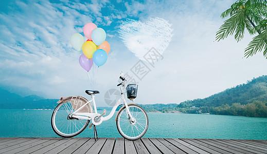 海边带着气球的自行车图片