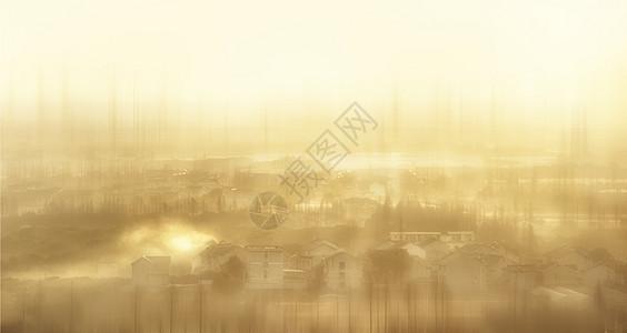 阳光下晨雾中的村庄图片