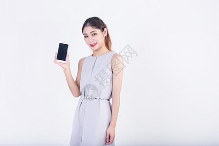 商务套裙女性展示手机高清图片