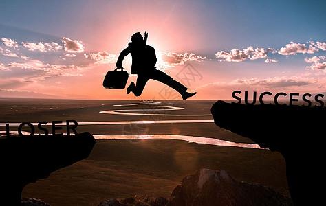 商务人士跳跃成功图片