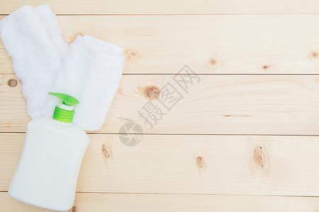 毛巾沐浴露平铺背景图片