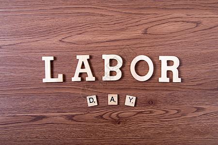 劳动节木纹木板背景图片