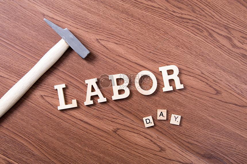 劳动节英文字母木板背景