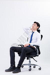 坐在办公椅上闭目休息放松图片