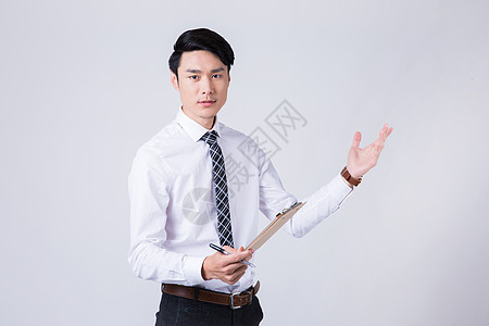 时尚商务男士微笑介绍手势图片