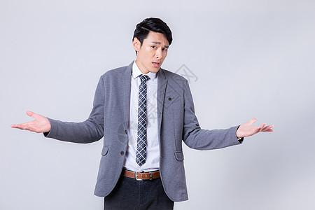 无奈吃惊的商务男性形象图片