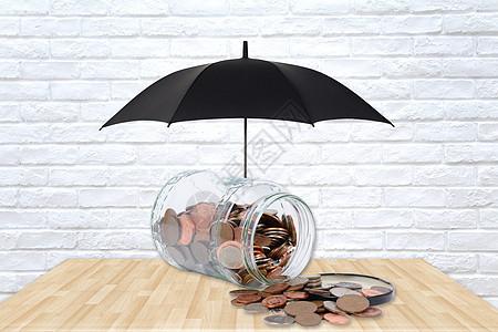商业存钱罐的保护伞概念图图片