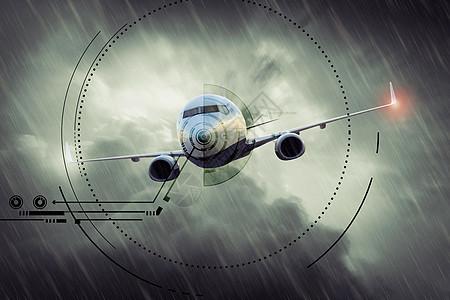 阴雨天乌云上的飞机图片
