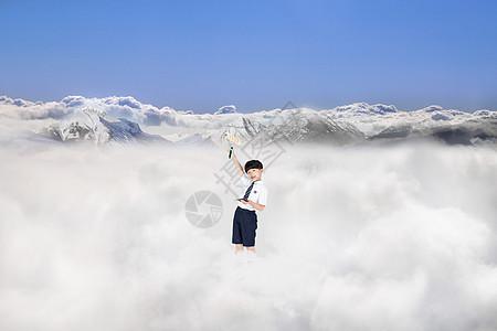 小孩在天空中攀爬梯子玩耍图片