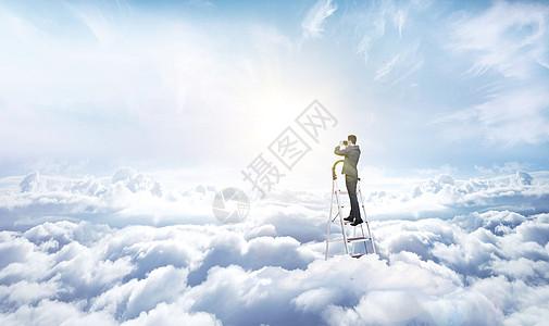 商业人像西装职场人士攀爬梯子登高挑战成功图片