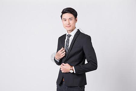 商务白领整理服装着装西装衣领