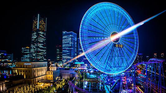 城市科技夜晚的摩天轮图片