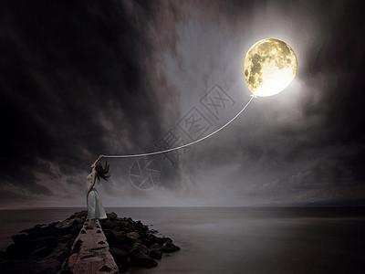 牵着月亮的女孩图片