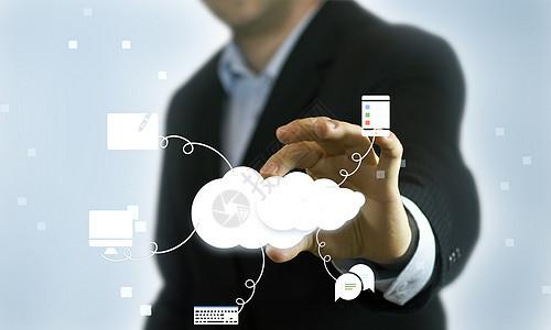 智能云服务科技商务人士拿捏云朵图片