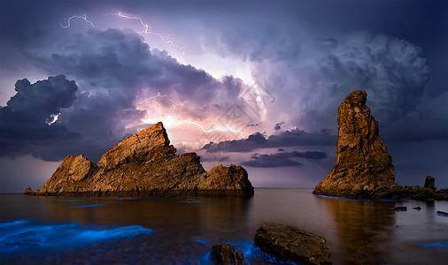 闪电礁石荧光海图片