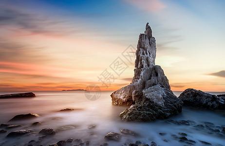 无边无际的夕阳海景礁石图片