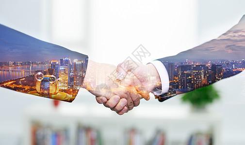商务城市握手图片