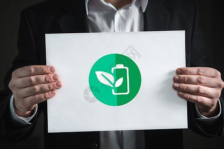手持绿色环保标志图片