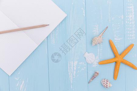 夏日蓝色木板海星书写素材图片
