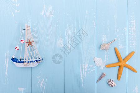 夏日蓝色木板帆船海星素材图片