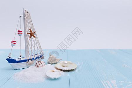 夏日沙滩珍珠海星帆船素材图片