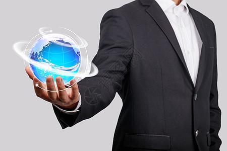 商务男手持科技地球图片