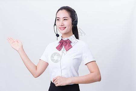 商业亲和力美女客服举手手势图片