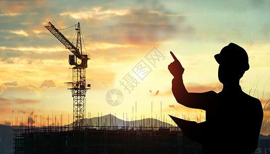 夕阳下的建筑工人图片