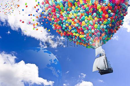 彩色氢气球载着帆船在蓝天白云中飞行图片
