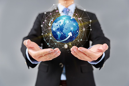 智能科技时代商务男士托举地球图片