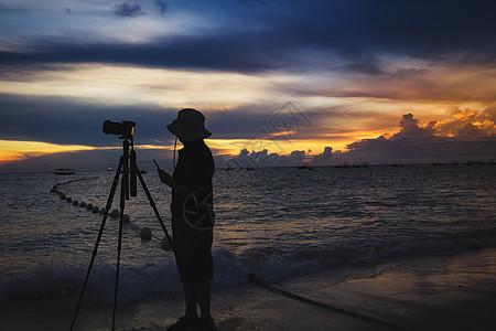 海边的摄影师图片