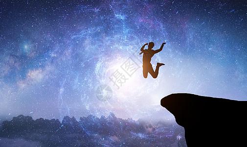 在星空中从悬崖上跳下的人物图片