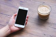 手拿手机商务背景素材图片