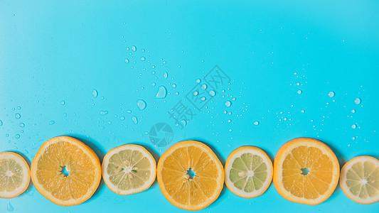 夏日清新蓝色背景水果橙子图片