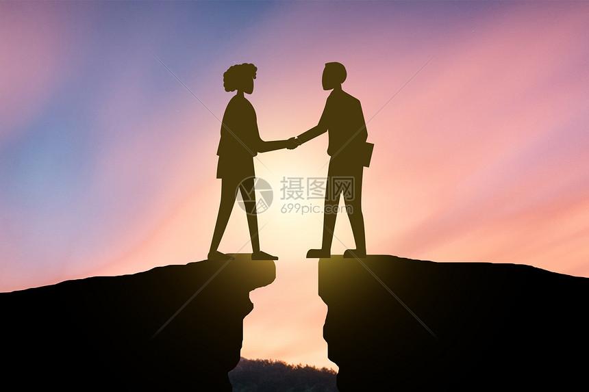 悬崖上的人们给自己一个握手的机会图片