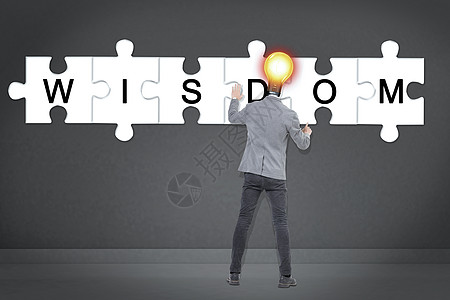 商务灯泡男手持拼图图片