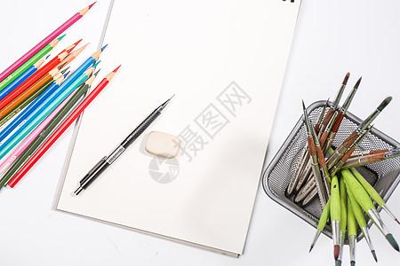 画笔与绘画本创意组合图片
