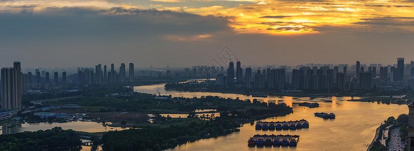 城市海滨河滨落日图片