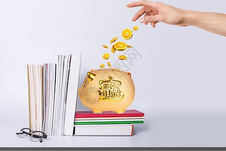 伸手向存钱罐里丢金币图片