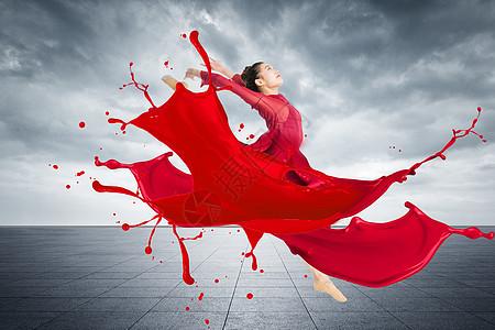 穿着红色油漆长裙跳舞的女性图片