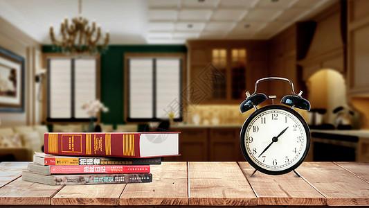 老旧书桌上的钟表和书图片