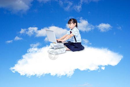 坐在云层中学习的孩子图片