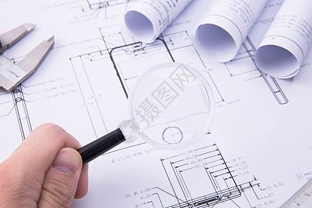 工程图纸与游标卡尺图片