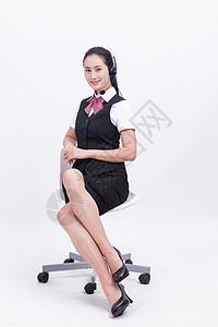 商务职业美女客服坐在椅子上图片