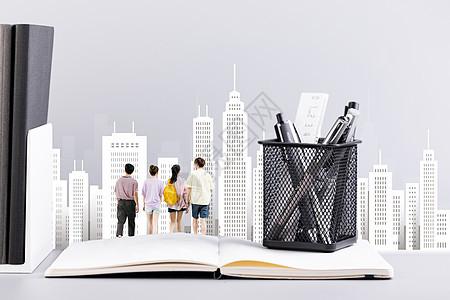 学生背着书包走在打开的书上图片